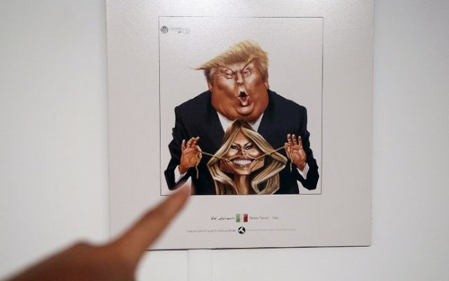 A picture taken on July 3, 2017 shows a cartoon of US President Donald J. Trump and First Lady Melania Trump on display at an exhibition of the Islamic Republic's 2017 International Trumpism cartoon and caricature contest, in the capital Tehran.  (ATTA KENARE / AFP)