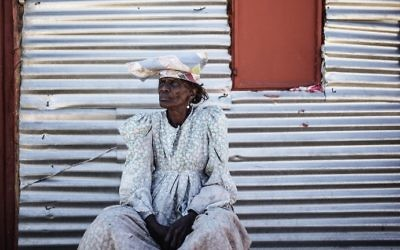 Namibian woman Sarafia Komomungondo siits by a corrugated iron shack on the outskirts of the impoverished Namibian town of Okakarara on June 22, 2017. (AFP Photo/Gianluigi Guercia)