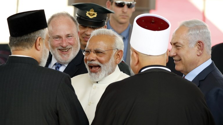 Prime Minister Benjamin Netanyahu (R) introduces his Indian counterpart Narendra Modi (C) to religious leaders during an official ceremony at Ben Gurion International Airport on July 4, 2017. (AFP Photo/Jack Guez)