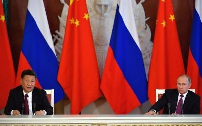 Russian President Vladimir Putin and his Chinse counterpart Xi Jinping make a statement during a signing ceremony in the Kremlin in Moscow on July 4, 2017. (AFP Photo/Alexander Nemenov)