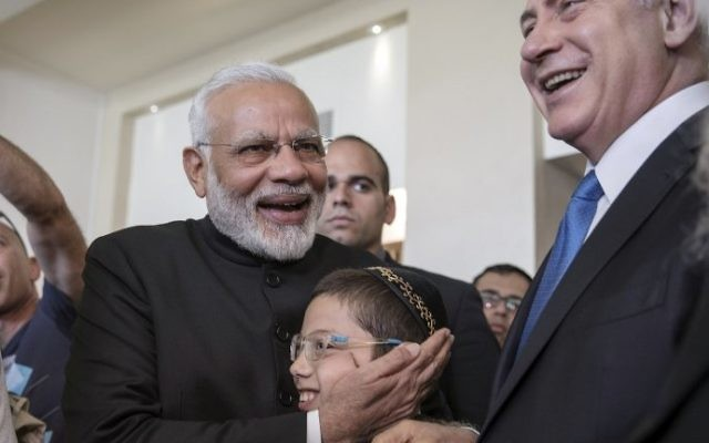 Indian Prime Minister Narendra Modi (C-L) embraces Moshe Holtzberg (C), son of slain US Rabbi Gavriel Holtzberg who was killed with his wife in the November 26, 2008 attacks on the Nariman Chabad house in Mumbai, on July 5, 2017.   (AFP Photo/Pool/Atef Safadi)