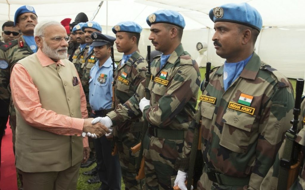 Indian Prime Minister Narendra Modi greets members of the Indian contingent of UNIFIL  during a visit at the the Indian Army Cemetery of the World War I in Haifa, on July 6, 2017.  (AFP/JACK GUEZ)