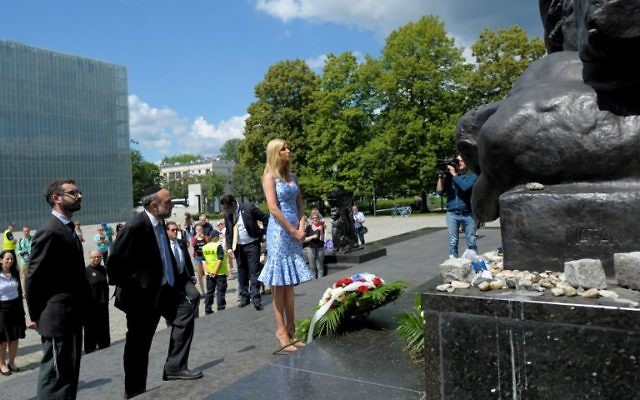 Ivanka Trump and Chief Rabbi of Poland Michael Schudrich, 2nd left, lay flowers in front of the memorial Monument for the Ghetto Heroes in Warsaw, Poland, July 6, 2017. (AFP/PAP /Przemyslaw PIATKOWSKI)