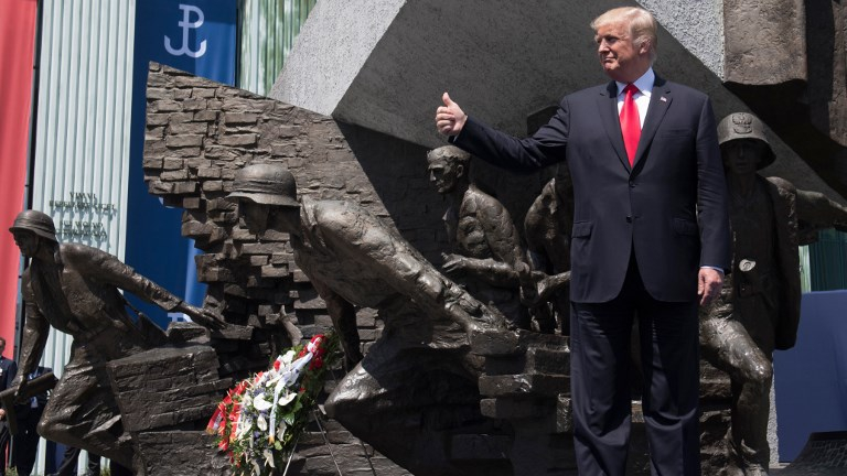 US President Donald Trump holds his thumb up as he stands in front of the Warsaw Uprising Monument on Krasinski Square during the Three Seas Initiative Summit in Warsaw, Poland, July 6, 2017. (SAUL LOEB / AFP)
