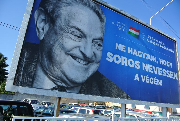 A poster with US billionaire George Soros is pictured on July 6, 2017 in Szekesfehervar, Hungary. (AFP PHOTO / ATTILA KISBENEDEK)