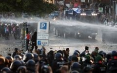 Riot police use water cannons during the 'Welcome to Hell' rally against the G20 summit in Hamburg, Germany, on July 6, 2017. (AFP Photo/Odd Andersen)