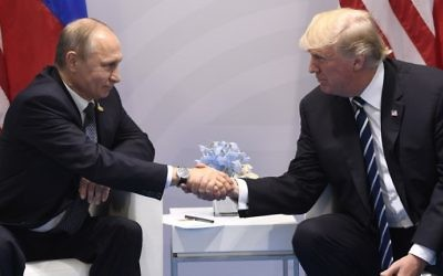 US President Donald Trump and Russia's President Vladimir Putin shake hands during a meeting on the sidelines of the G20 Summit in Hamburg, Germany, on July 7, 2017. (AFP Photo/Saul Loeb)