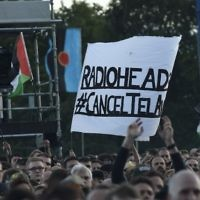 Pro-Palestinian supporters protest against Radiohead's planned concert in Tel Aviv at the TRNSMT music Festival in Glasgow, Scotland,  July 7, 2017.  (AFP/Digital/Andy Buchanan)
