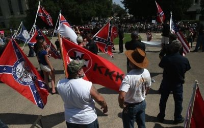 This file photo taken on July 17, 2015 shows Ku Klux Klan members staging a demonstration at the state house building in Columbia, South Carolina. (AFP/Getty Images North America/John Moore)