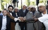 Illustrative image of the Imam of Drancy, Hassen Chalghoumi (C), Lebanese Imam Mohammad Ali Al-Husseini (2L) Egyptian Sheikh Ahmed Mohamed el-Tayeb (3R) posing with others as they prepare to take part in The Muslim March Against Terrorism in Paris on July 8, 2017. (AFP/Francois Guillot)