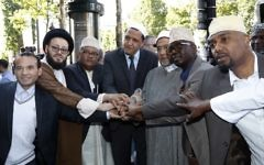 The Imam of Drancy, Hassen Chalghoumi (C), Lebanese Imam Mohammad Ali Al-Husseini (2L) Egyptian Sheikh Ahmed Mohamed el-Tayeb (3R) pose with others as they prepare to take part in The Muslim March Against Terrorism in Paris on July 8, 2017. (AFP/Francois Guillot)