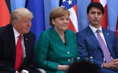 From left to right: US President Donald Trump, German Chancellor Angela Merkel and Canada's Prime Minister Justin Trudeau on the second day of the G20 Summit in Hamburg, Germany, July 8, 2017. (AFP/Pool/Patrik Stollarz)