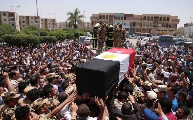 Egyptians carry the coffin of a soldier, who was killed a day earlier in the restive Sinai Peninsula in an attack by the Islamic State group, during a funeral ceremony in the 10th of Ramadan city, about 60 kms north of Cairo, on July 8, 2017 (AFP PHOTO / MAHMOUD BAKKAR)