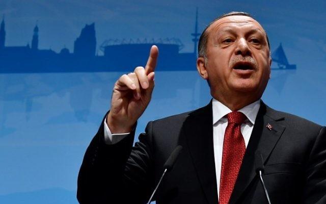Turkey's President Recep Tayyip Erdogan addresses a press conference at the G20 Summit in Hamburg, Germany, July 8, 2017. (AFP Photo/Tobias Schwarz)