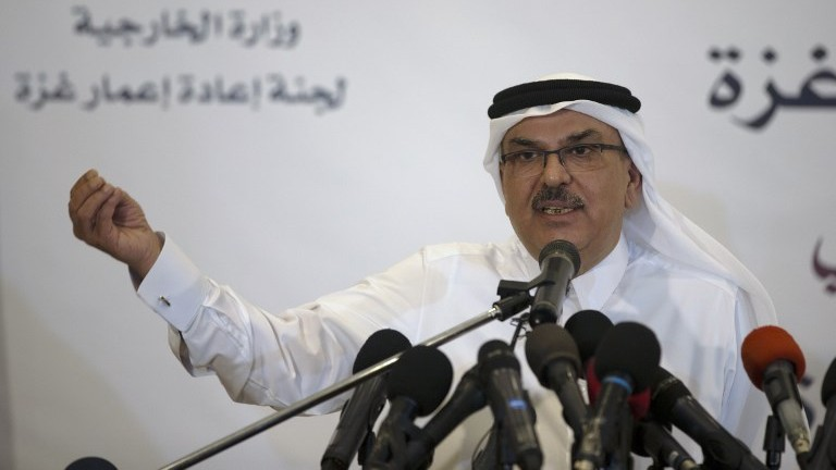 Qatar's ambassador to Gaza Mohammed al Emadi speaks during a press conference with UN Special Coordinator for the United Nations for the peace process in the Middle East in Gaza City