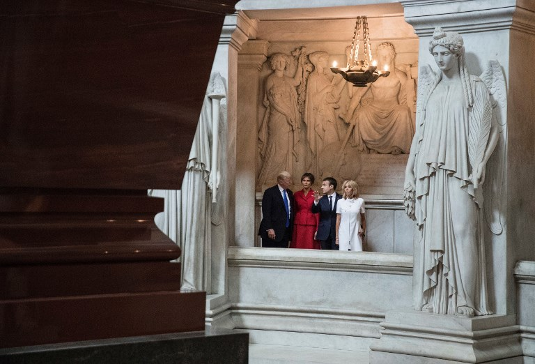 (From L) US President Donald Trump, First lady Melania Trump, French President Emmanuel Macron, and his wife Brigitte Macron visit Napoleon Bonaparte's tomb at Les Invalides in Paris, on July 13, 2017. (AFP PHOTO / POOL AND AP / Carolyn Kaster)