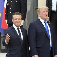 US President Donald Trump (R) and French President Emmanuel Macron (L) leave after a joint press conference following meetings at the Elysee Palace in Paris, on July 13, 2017. (bertrand GUAY / AFP)