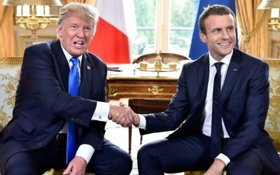 French President Emmanuel Macron (R) shakes hands with US President Donald Trump (L) during a meeting at the Elysee Palace in Paris on July 13, 2017. (AFP Photo/Pool/Alain Jocard)