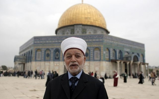 (FILES) This file photo taken on November 6, 2015 shows Jerusalem's Mufti Mohammed Hussein posing in front of the Dome of the Rock mosque at the Al-Aqsa mosque compound, in Jerusalem's Old City. (Ahmad Gharabli/AFP)