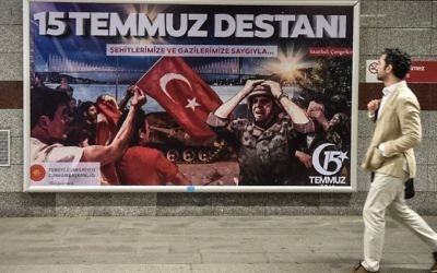 A man walks past a giant billboard reading 'Legend of July 15' for the anniversary of the last year's attempted coup in Turkey, on July 14, 2017 in Istanbul. (Ozan Kose/AFP)