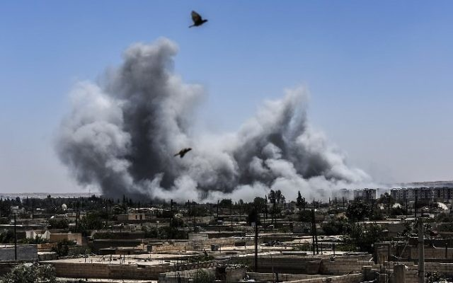 Illustrative: Smoke billows following an airstrike on the western frontline of Raqqa, Syria, July 15, 2017. (AFP/Bulent Kilic)