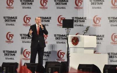 "Turkey's President Recep Tayyip Erdogan delivering a speech at a ceremony site on ""July 15 Martyrs Bridge"" (Bosphorus Bridge) in Istanbul on July 15, 2017. (AFP PHOTO / OZAN KOSE)"