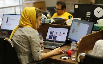 Bamilo employees work at the e-commerce site's offices in the Iranian capital Tehran on July 9, 2017. (AFP/ATTA KENARE)