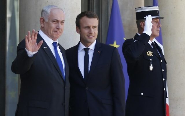 File: Prime Minister Benjamin Netanyahu, left, waves as he stands next to French President Emmanuel Macron, right, upon his arrival at the Elysee Palace, in Paris, on July 15, 2017 ahead of their meeting. (AFP Photo/Geoffroy Van Der Hasselt)