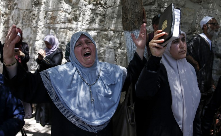 Palestinian women chant slogans outside the Temple Mount / Al-Aqsa mosque compound, protesting new security measures introduced on July 16, 2017, after a terror attack on July 14. (AFP PHOTO / AHMAD GHARABLI)