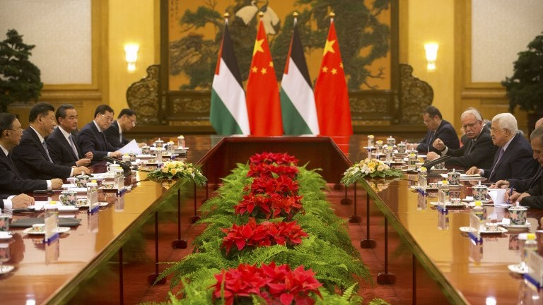Chinese President Xi Jinping (L) listens as Palestinian Authority President Mahmoud Abbas (R) speaks during a meeting at the Great Hall of the People in Beijing on July 18, 2017. (AFP Photo/Pool/Mark Schiefelbein)