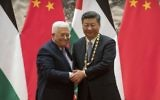 Palestinian Authority President Mahmoud Abbas (L) shakes hands with Chinese President Xi Jinping during a signing ceremony at the Great Hall of the People in Beijing on July 18, 2017. (AFP Photo/Pool/Mark Schiefelbein)