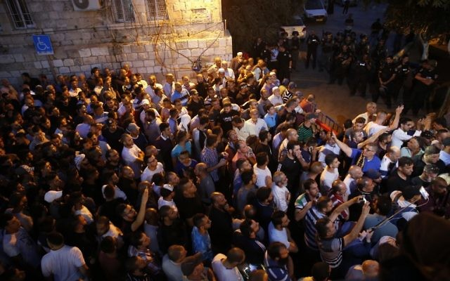 Palestinian Muslim worshipers demonstrate next to Lions Gate in Jerusalem's Old City on July 18, 2017.(AFP/ AHMAD GHARABLI)