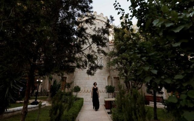 A woman attends the re-opening of the Sergei Compound in Jerusalem after six years of renovation work, July 18, 2017. (AFP PHOTO / GALI TIBBON)