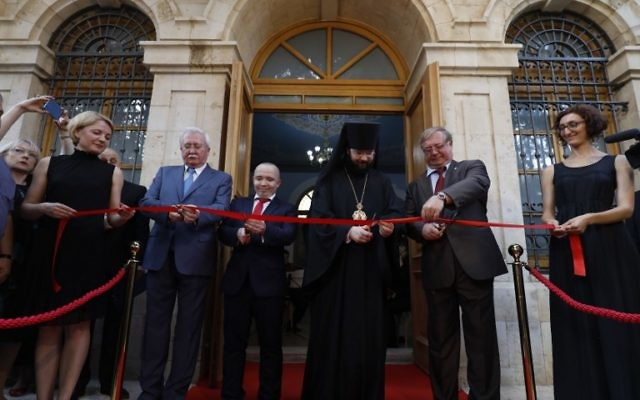 Members of a Russian delegation including former Russian prime minister Sergey Vadimovich Stepahin (2R) cut a ribbon during the re-opening of the Sergei Compound in Jerusalemafter six years of renovation work, July 18, 2017, (AFP PHOTO/GALI TIBBON)