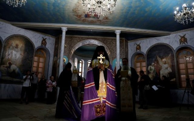 Russian-Orthodox religious figures attend the re-opening of the Sergei Compound in Jerusalem after six years of renovation work, July 18, 2017, (AFP PHOTO / GALI TIBBON)