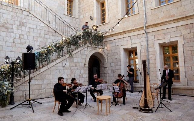Musicians play during the re-opening of the Sergei Compound in Jerusalem after six years of renovation work, July 18, 2017, (AFP PHOTO / GALI TIBBON)