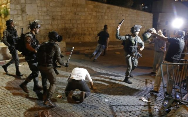 Israeli security forces clash with Palestinian demonstrators outside the Lion's Gate in Jerusalem's Old City on July 18, 2017. (AFP/Ahmad Gharabli)