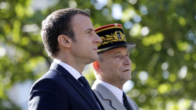 This file photo taken on July 14, 2017, shows French President Emmanuel Macron (L) and Chief of Staff General Pierre de Villiers during the annual Bastille Day military parade on the Champs-Elysees in Paris. (AFP Photo/Pool/Etienne Laurent)
