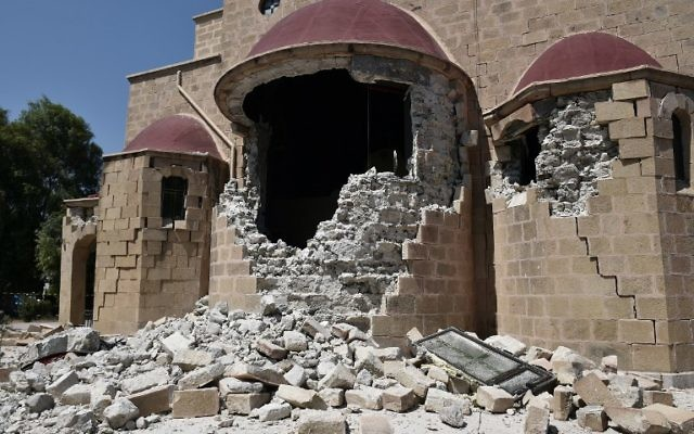 This pictures taken on July 21, 2017 shows an exterior view of the quake-damaged Church of Saint Nicholas on the Greek Island of Kos following a 6.5 magnitude earthquake which struck the region. (AFP/Louisa Gouliamaki)