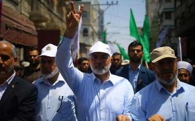 Hamas leader Ismail Haniyeh, center, and spokesman Fawzi Barhoum attend a protest in Gaza City on July 22, 2017, against new Israeli security measures implemented at the holy site, which include metal detectors and cameras, following an attack that killed two Israeli policemen the previous week. (AFP/Mohammed Abed)