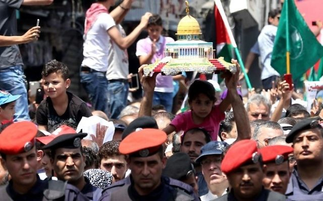 Jordanians carry a model of the Dome of the Rock shrine during a demonstration, called for by the Islamic Action Front, in Amman following friday prayers on July 21, 2017, to protest against new Israeli security measures implemented at the holy site, which include metal detectors and cameras, following an attack that killed two Israeli policemen the previous week. (AFP/Khalil Mazraawi)