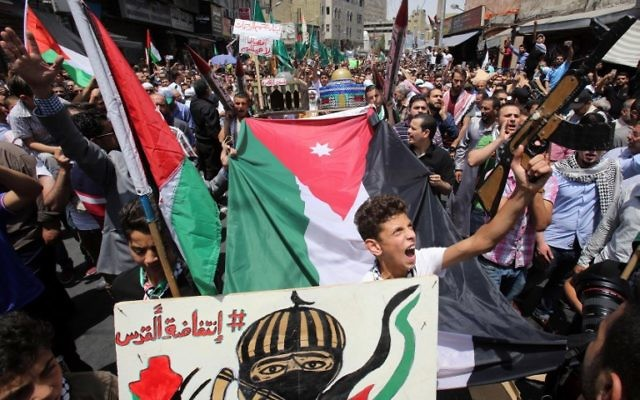 Jordanians shout slogans during a demonstration, called for by the Islamic Action Front, in Amman following Friday prayers on July 21, 2017, to protest against new Israeli security measures implemented at the Temple Mount. (AFP/ Khalil MAZRAAWI)