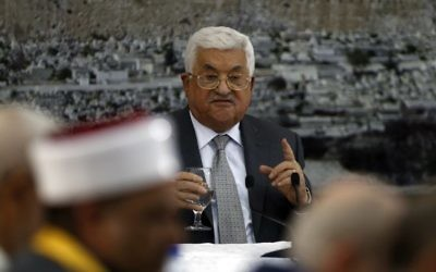 Palestinian Authority President Mahmoud Abbas gives a speech during a meeting of Palestinian leadership in the West Bank city of Ramallah on July 21, 2017, during which he announced freezing all contacts with Israel. (AFP/Abbas Momani)