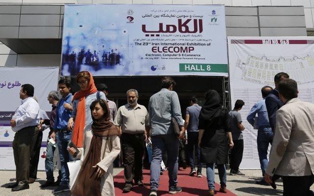 Visitors attend the Elecomp tech fair in the Iranian capital Tehran, July 23, 2017. (AFP/ATTA KENARE)