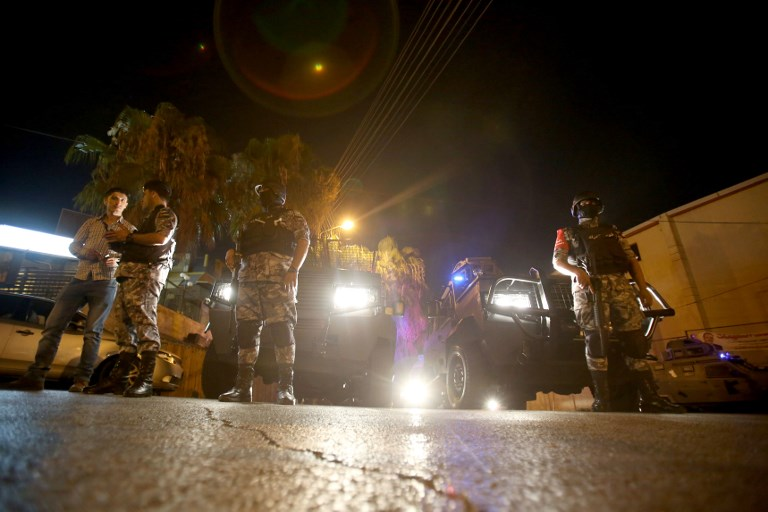 Security forces stand guard outside the Israeli embassy in the residential Rabiyeh neighborhood of the Jordanian capital Amman, on July 23, 2017.(AFP/Khalil Mazraawi)