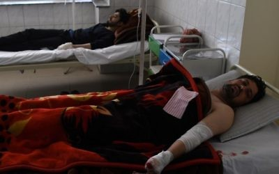 Afghan men, at a hospital, after being injured in a car bomb attack in Kabul on July 24, 2017. (AFP Photo/Shah Marai)