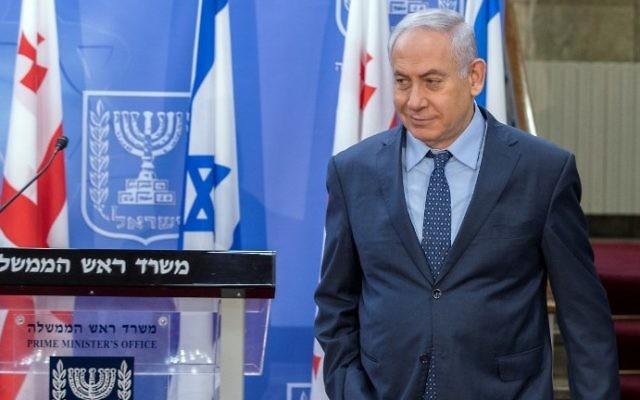 Prime Minister Benjamin Netanyahu arrives for a press conference with his Georgian counterpart Giorgi Kvirikashvili at his office in Jerusalem on July 24, 2017. (AFP PHOTO / POOL / JACK GUEZ)