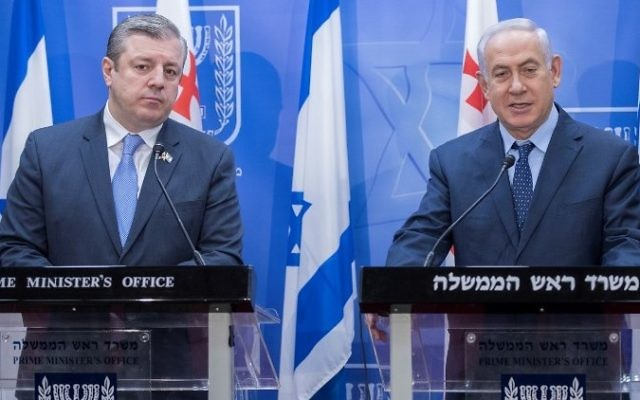 Prime Minister Benjamin Netanyahu, right, and his Georgian counterpart Giorgi Kvirikashvili hold a press conference at the prime minister's office in Jerusalem on July 24, 2017. (AFP/POOL/JACK GUEZ)