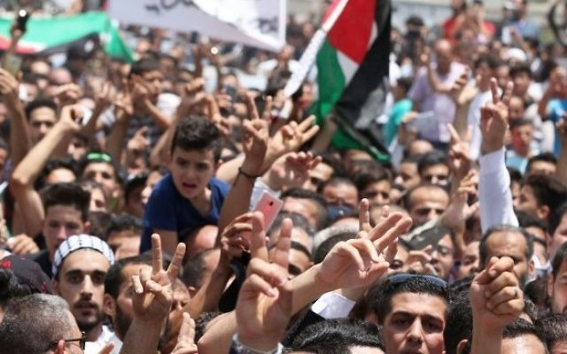Mourners attend the funeral of 17-year-old Mohammed Jawawdeh, who was killed when he allegedly attacked a security guard at the Israeli embassy compound in the Jordanian capital with a screwdriver, on July 25, 2017, in Amman. (Khalil Mazraawi/AFP)
