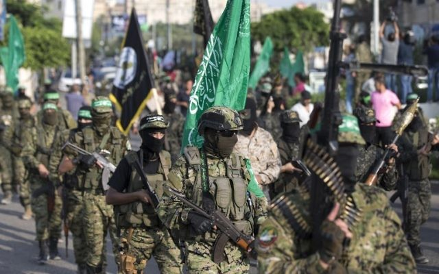 Palestinian members of the Izz ad-Din al-Qassam Brigades, the armed wing of the Hamas terror movement, take part in a military parade against Israel in Gaza City, July 25, 2017. (AFP/Mahmud Hams)